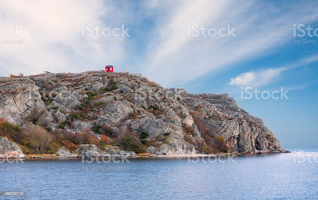 Small red house on the top of mountain stock photo
