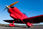 small red propeller plane