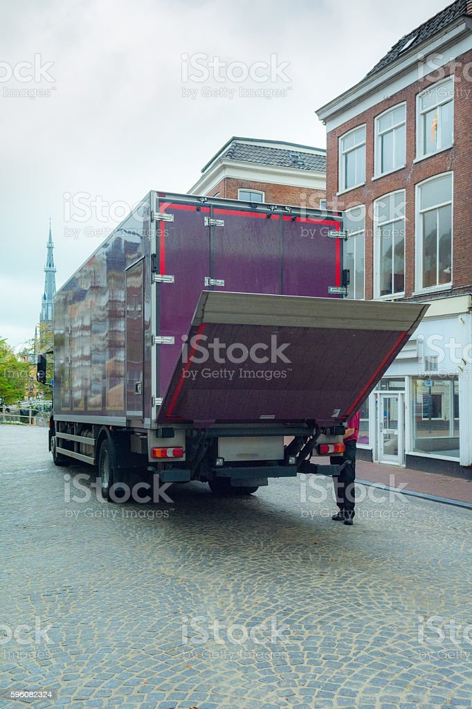small refrigerated truck for food delivery man opening  tailgate royalty-free stock photo