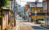 Small residential street in Nagano Japan with a few stores on each side.