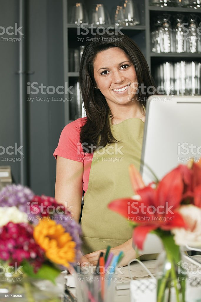 Small Retail Business Shopkeeper Standing at Checkout Counter, Flower Shop royalty-free stock photo