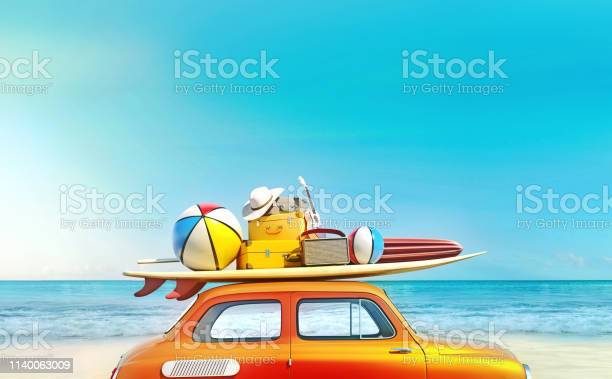 Photo of Small retro car with baggage, luggage and beach equipment on the roof, fully packed, ready for summer vacation, concept of a road trip with family and friends, dream destination, very vivid colors with dominant blue sky and ocean and bright orange car.