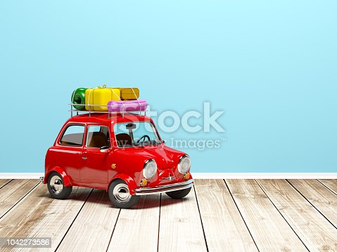 istock small retro travel car on floor 1042273586