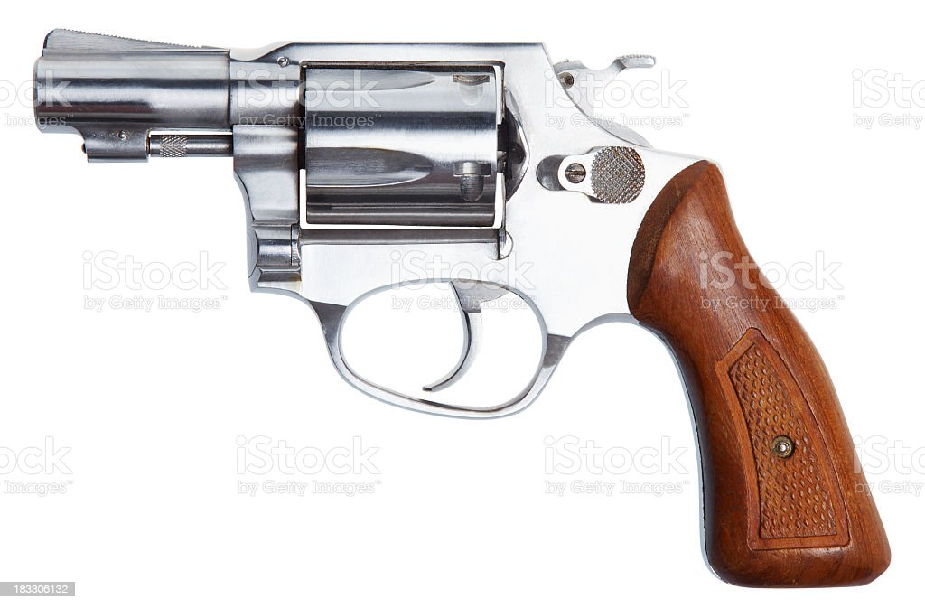 A small Revolver with a wooden handle stock photo