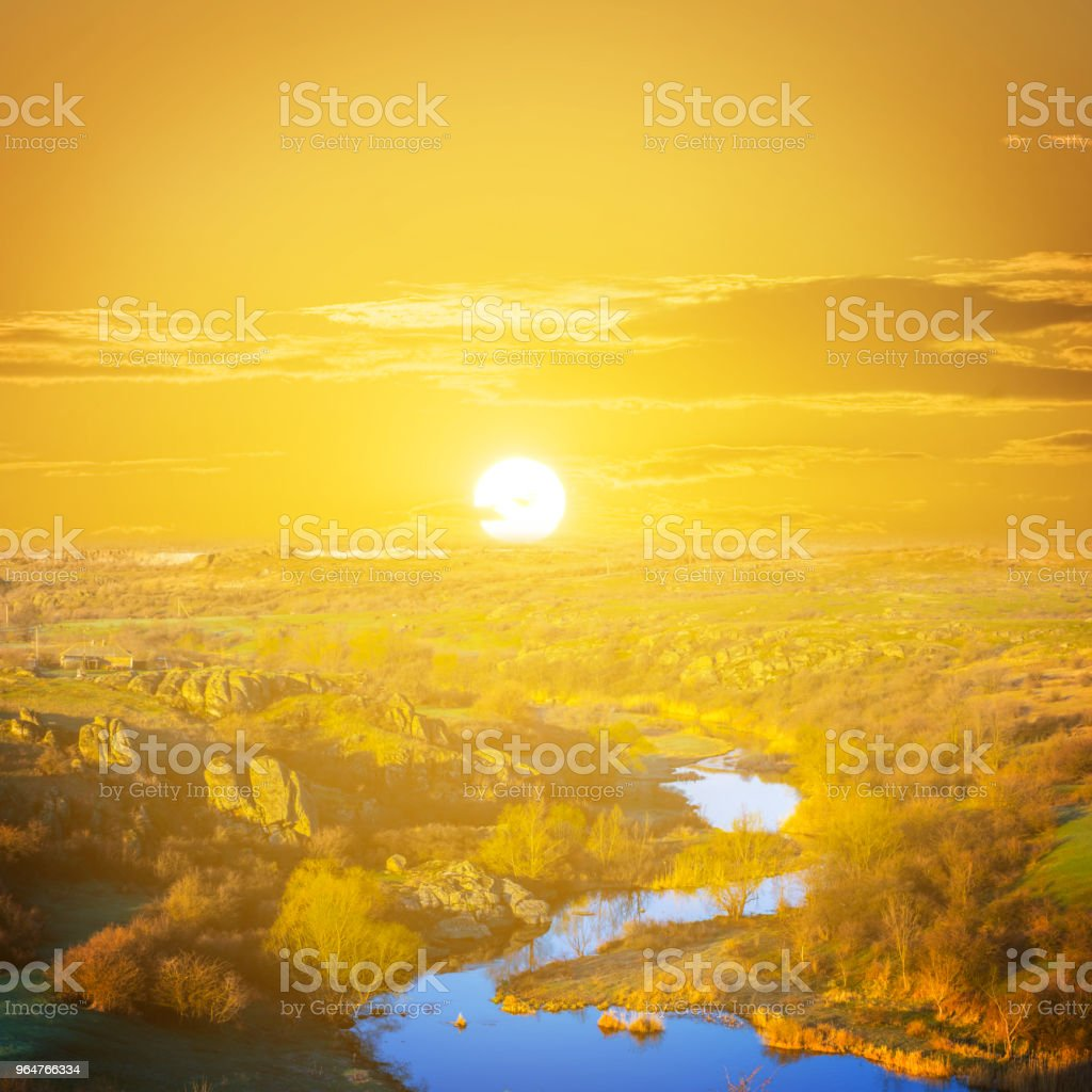 small river flow through a canyon at the sunset royalty-free stock photo