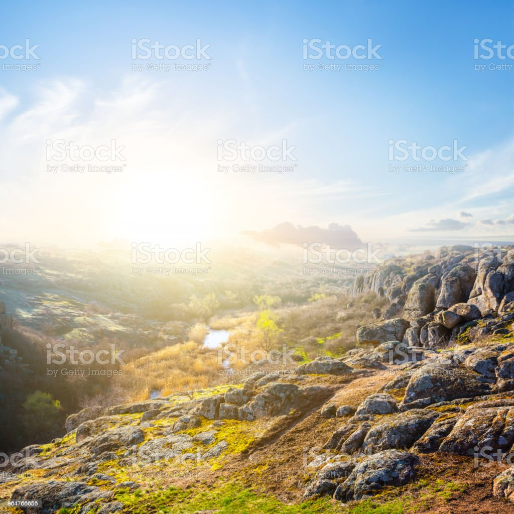 small river flow through a mountain canyon at the sunset royalty-free stock photo