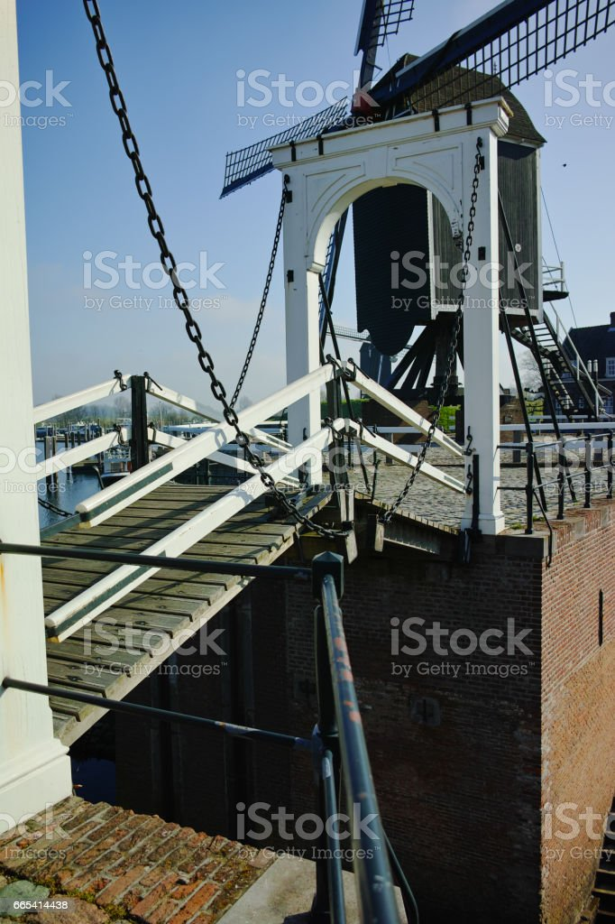 Small river harbor, drawbrige and windmill in Heusden - old village in Brabant stock photo