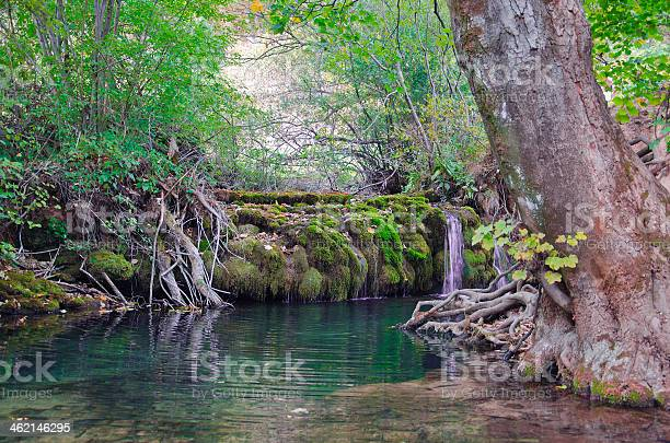 Photo of Small river with a  waterfall