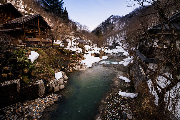Small river with snow stock photo