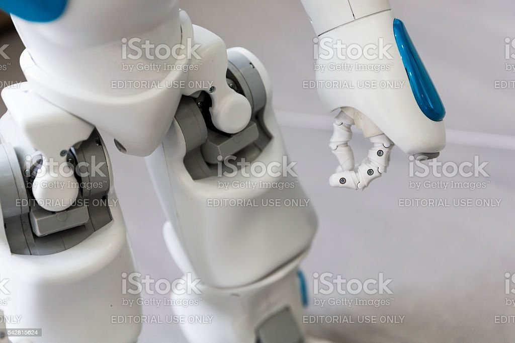 Small robot with human face and body. Hand and legs. stock photo