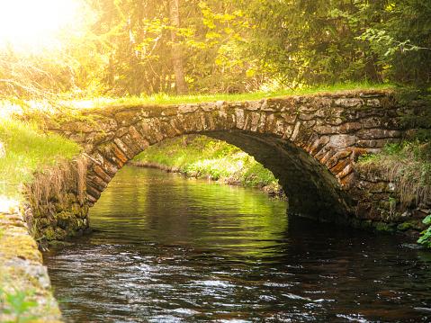 Small rock bridge over forest channel, Vchynice-Tetov Transport Channel, Sumava, aka Bohemian Forest, Czech Republic