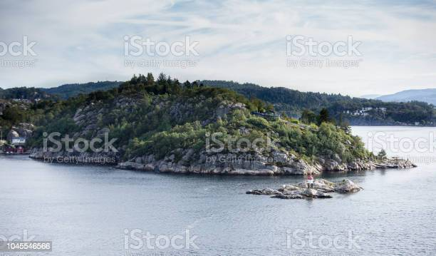 Small Rocky islands in Fjord shoreline morning time) Bergen, Norway