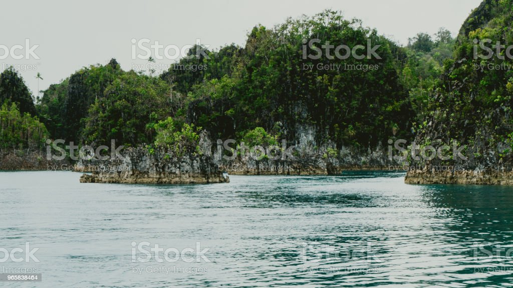 Small rocky islands in Pianemo, Raja Ampat, West Papua, Indonesia - Royalty-free Adventure Stock Photo