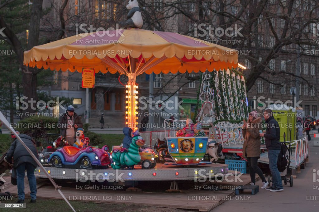 Small roundabout, fun for children at Christmas market stock photo