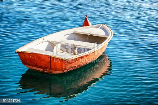 small row boat - handmade - at a lake