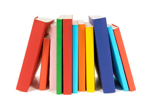 Small row of books isolated on white background .