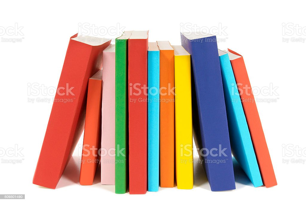 Small row of books isolated on white background . stock photo