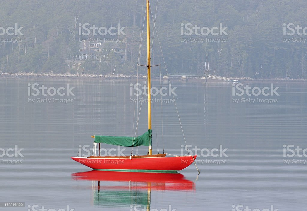 Small sailboat moored in calm water. royalty-free stock photo