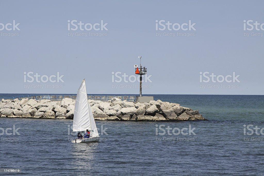 Small Sailboat Near The Exit From Harbor royalty-free stock photo