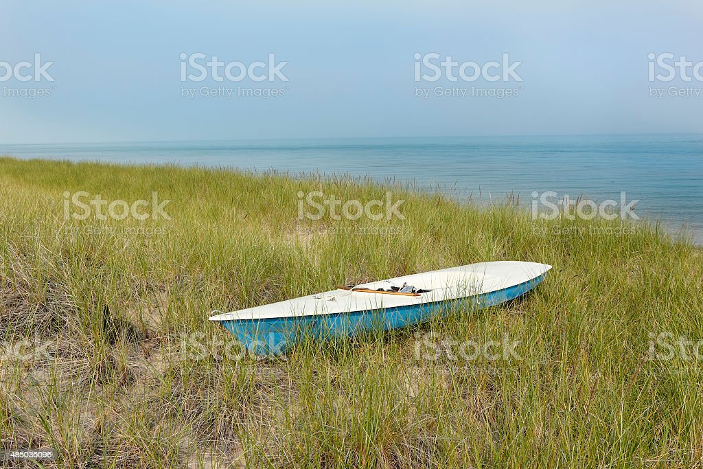 Small Sailboat Sitting in Dune Grass Next to Lake Huron stock photo