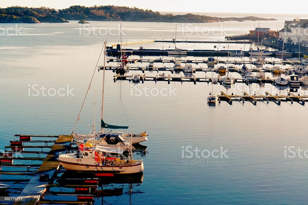 Small sailboats in the harbor stock photo