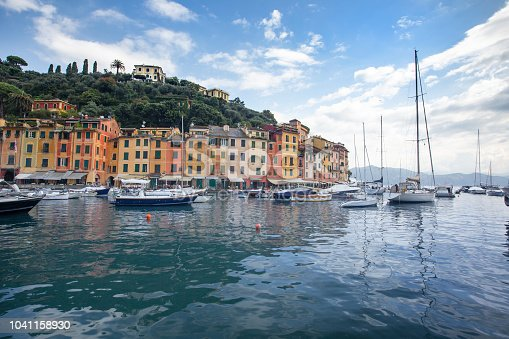 Small sailing boats moored in the beautiful small fishing port of Portofino bay. It is coatal gem situated near Genoa. famed for its picturesque harbour and celebrity visitors.