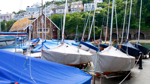 Small sailing boats A group of small sailing boats o the harbour-side sailing dinghy stock pictures, royalty-free photos & images
