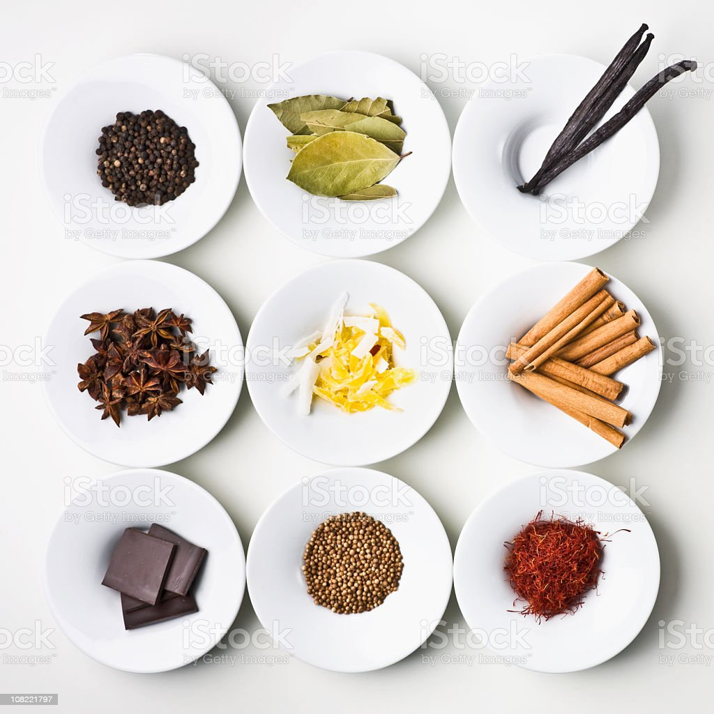 Small samples of world food items organized onto plates stock photo