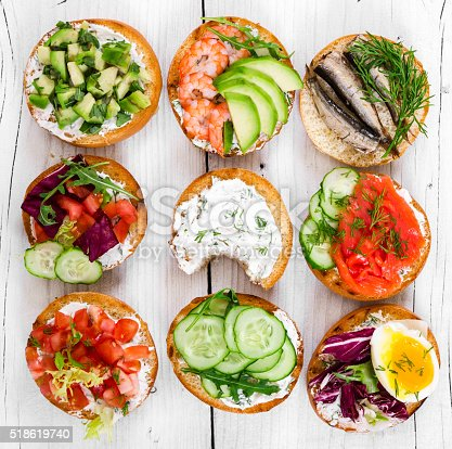 istock Small sandwiches on wooden background 518619740