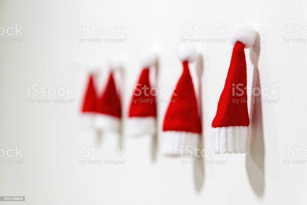 Small Santa Claus hats. Christmas craft. Making New Year decoration. Christmas ornaments stock photo