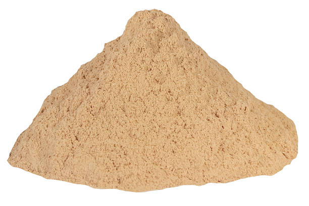 Small sawdust pile brown isolated white background stock photo