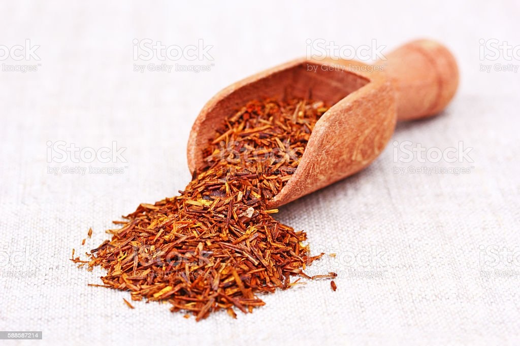 Small Scoop of Dried Rooibos Tea Leaves stock photo