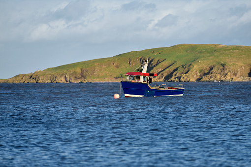 Small Scottish lobster boat moored in a bay