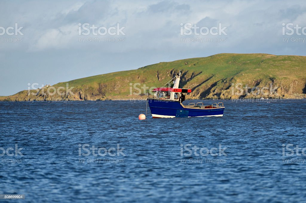 Small Scottish lobster boat moored in a bay stock photo