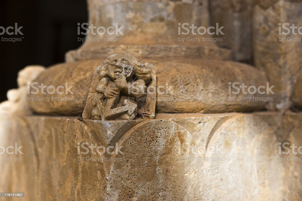 Small sculpture carved into the base of a column royalty-free stock photo