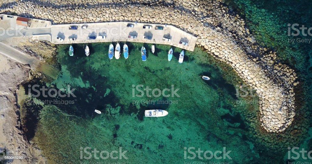 A small seaport. Blue beautiful bay. Cyprus. Resort. Mediterranean Sea. Transportation. Vacation foto de stock royalty-free