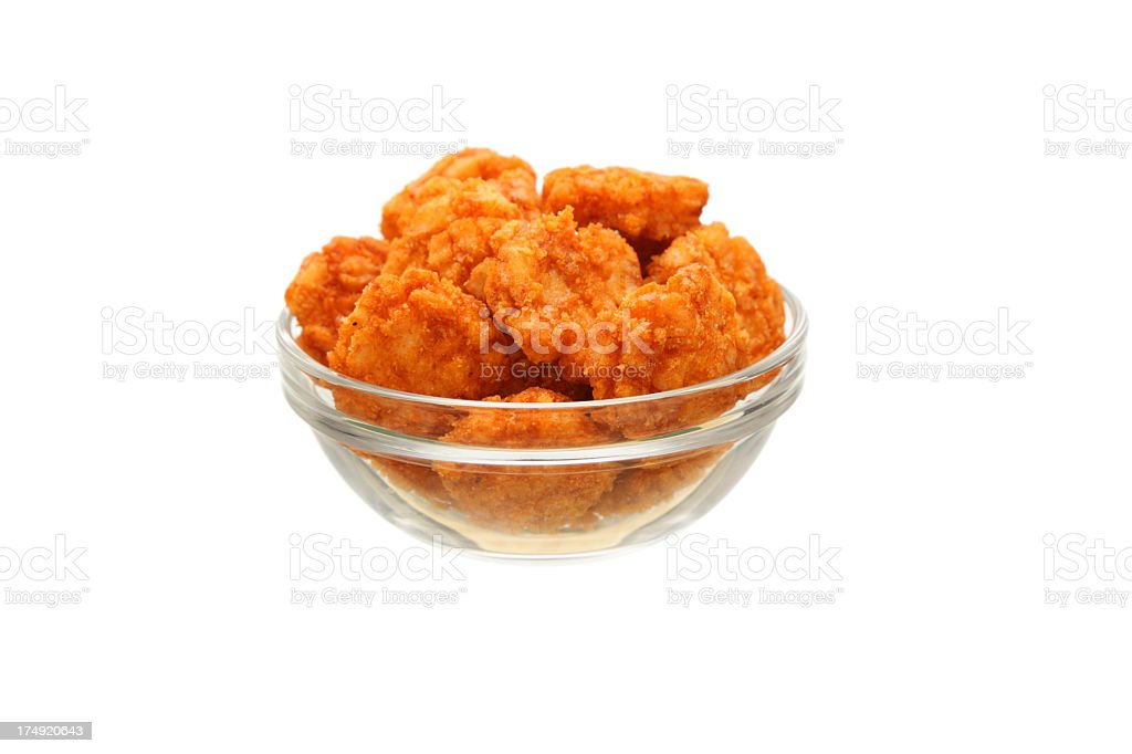 small serving of japanese chili rice crackers in glass bowl royalty-free stock photo