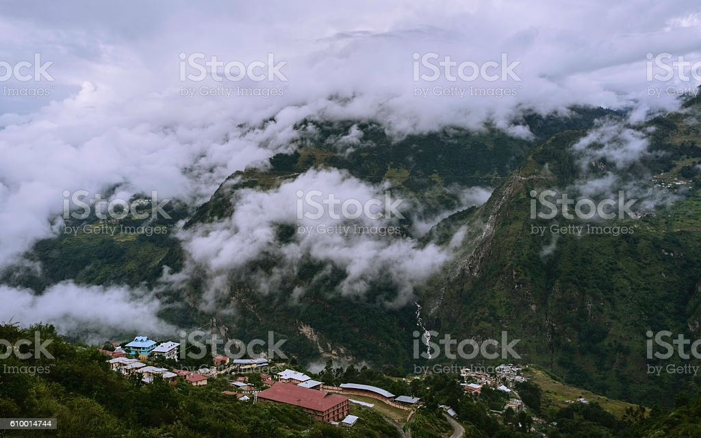 Small settlement in Himalayas at dawn, Arunachal Pradest, India. stock photo