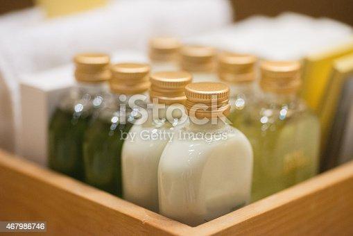 small shampoo bottles in wodden basket in hotel room
