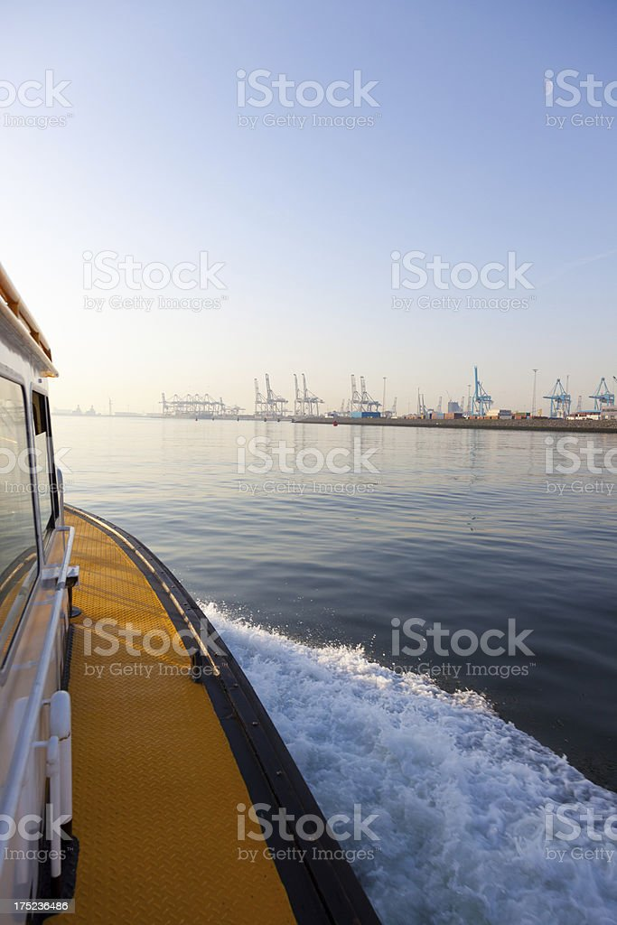 Small ship and industry stock photo