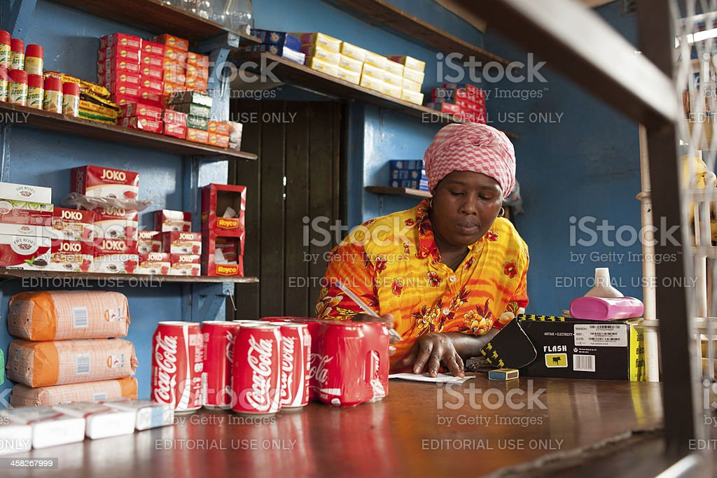 Small shop owner counting royalty-free stock photo