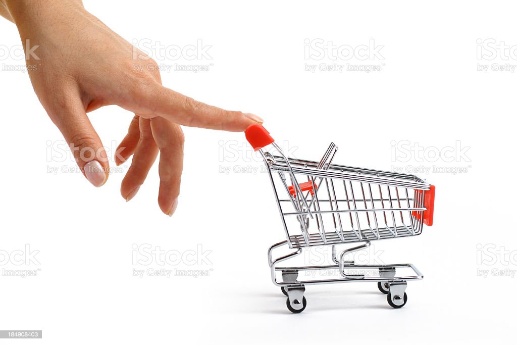 Small shopping cart been pushed royalty-free stock photo