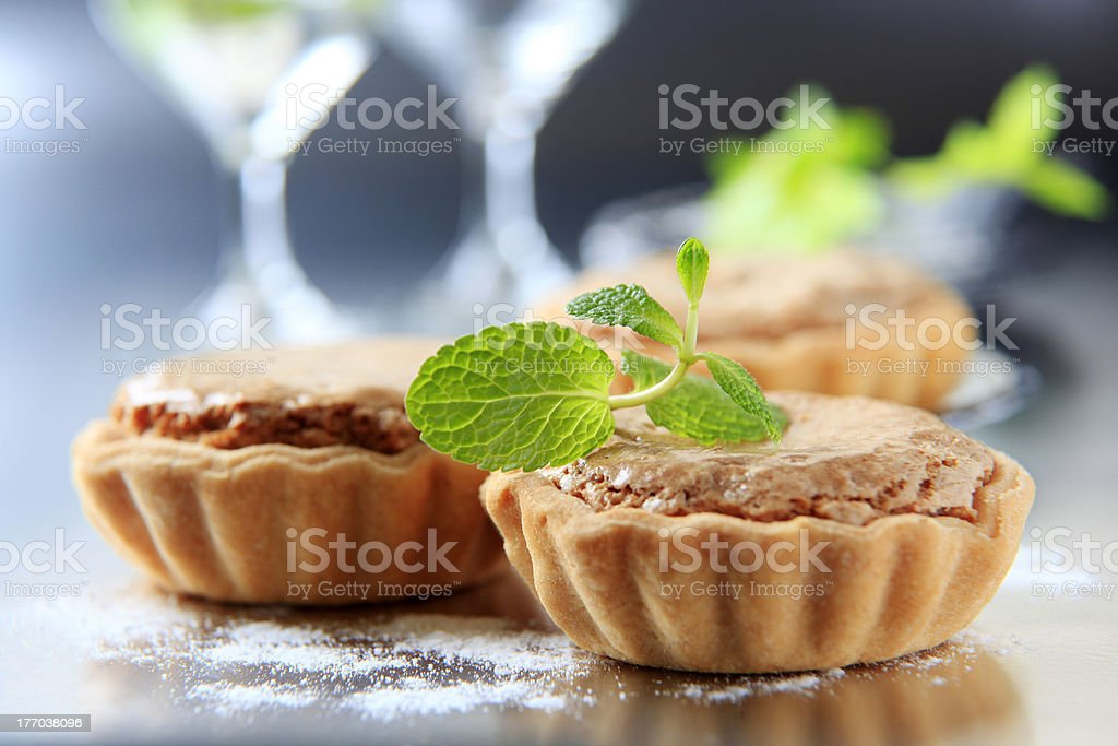 Small shortbread tart shells with nut filling royalty-free stock photo