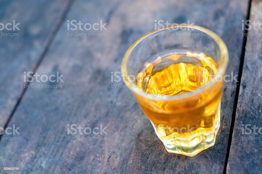 Small shot glass of alcoholic beverage stock photo
