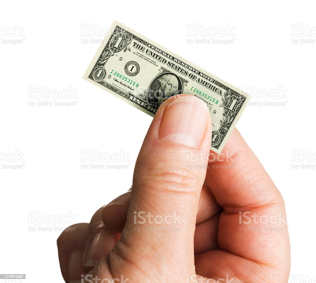 Small Shrinking Currency Dollar in Inflation on White Background stock photo
