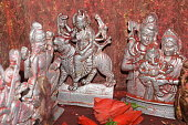 Small silver holly god statue on Worship room