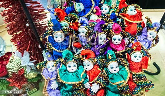889246424 istock photo Small sized ceramic Christmas dolls bunched up in a store's window display 1170017714