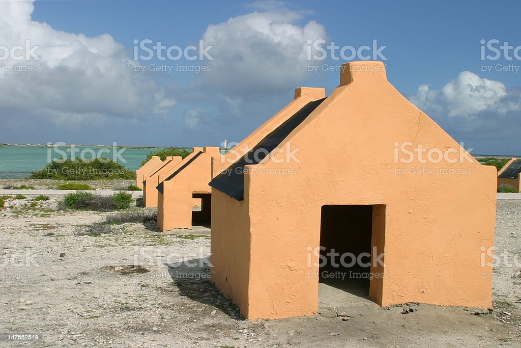 Small slave huts on Bonaire stock photo