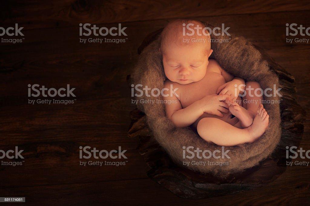 Small Sleeping Newborn Baby on Basket stock photo