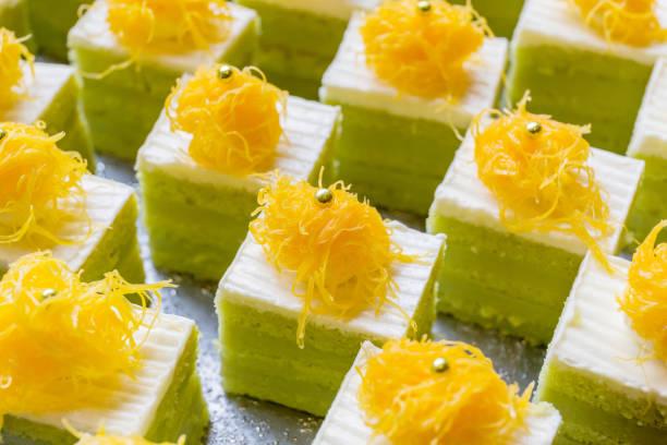 small sliced serve of panda cakes with traditional thai dessert (foi-thong) decoration on top. - pandan składnik zdjęcia i obrazy z banku zdjęć